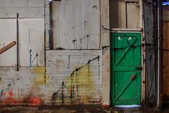 behind the green door (lowooley.) Tags: green door derelict factoty haltwhistle northernengland orange yellow paint splatter