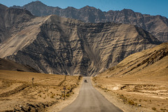 Life is a highway. I wanna ride it all night long (Robie..) Tags: ladakh landscape cars mountain desert highway india ladakhoctoberrobinmukherjeephotographymonastrieslandscapemo ladakhoctoberrobinmukherjeephotographymonastrieslandscapemountainsindia