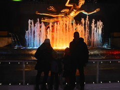 The Four Of Us On The Rockefeller Center Rink (Joe Shlabotnik) Tags: iceskating december2016 sue skating manhattan peter rockefellercenter statue prometheus 2016 newyorkcity proudparents backlit nyc violet fountain everett 60225mm