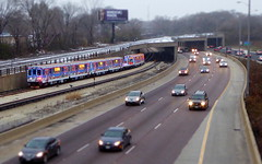The CTA Holiday Express Train running along side the Eisenhower (yooperann) Tags: cta chicago transit authority santa holiday express christmas train lights eisenhower expressway 290 forest oak park tiltshift