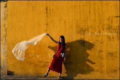 Wall.  Hoi An (Claire Pismont) Tags: asie asia viajar voyage vietnam vietnammars2016 yellow red jaune rouge jeunefemme women light lightandshadow veil voile wall mur hoian