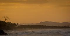 Sunset in Byron Bay (dlerps) Tags: ocean sunset sea orange cliff mountains tree beach monochrome silhouette clouds sunrise evening twilight sand surf waves sony sigma australia hills newsouthwales byronbay goldenlight sigmaapo70200mmf28exdghsm byronshire lerps sonyalphadslr diamondclassphotographer flickrdiamond sonyalphaa77v daniellerps