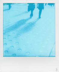 Cyan shadows (Skink74) Tags: uk england people london film walking polaroid sx70 shadows floor cyan instant docklands excel impossible silvertown polaroidlandcamera canningtown roidweek sx70alpha1se impossibleproject cyanograph cyanographsx70