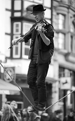 Songbird on a wire. (James Thomas 10375) Tags: street windows portrait people blackandwhite music 3 coffee hat shirt canon buildings eos wire bokeh mark candid iii jeans jacket starbucks violin oxford instrument trousers 5d balance f2 busker spectators ef mk onlookers 135mm 135l