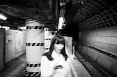Kokkai-Gijidõmae. (Davide Filippini ダビデ・フィリッピーニ) Tags: blackandwhite bw motion blur film monochrome japan analog subway tokyo blurry women metro grain blurred ilfordhp5 日本 hp5 東京 ilford 人 地下鉄 mosso leicam6 grana tokyometro sfocato tokyosubway モノクロ 白黒 japanesewomen 東京メトロ kokkai 人間 日本人 女性 国会 tokyobw 国会議事堂前 ボケ japanbw ストリート フィルム 黒白 アナログ 日本人女性 日本女性 ultron28 tokyomonochrome japanblackandwhite davidefilippini japanmonochrome 国会議事堂前駅 穀物 tokyoblackandwhite イルフォード モノクロフィルム ライカm6 ブラー ストリートフォトグラフィー モーション 東京モノクロ 東京白黒 ダヴィデ・フィリッピーニ ダビデ・フィリッピーニ 日本モノクロ 日本白黒 日本黒白 東京黒白 ぼやけた写真 ウルトロン28 グレイン kokkaigijidõmae イルフォードhp5 ふさわしい