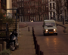 Vintage Amsterdam (Through the lens of a local) Tags: auto road street old city bridge houses red brown house holland reflection green netherlands car amsterdam stairs vintage lights licht canal europa europe groen nederland scooter headlights sidewalk nostalgia nostalgic poles brug rood trap oude stad nostalgie oldfashioned trottoir stoep bruin gracht straat rode paaltjes reflectie amsterdammertje ouderwets grachtenpand trapje nostalgisch ouderwetse