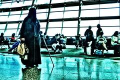 clash of cultures (micagoto) Tags: airport flughafen islam frau woman religion west burka burqa chadri burqu niqab quran