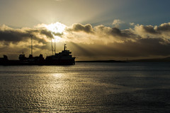 Sun rising over scapa flow (Malcolm Murray) Tags: sillhouette orcadian winter water sea scapa morning boats sunrise scapaflow clouds ocean sun blue atlantic scotland ship light north shipping stromness orange boat rising scottish harbour orkney