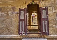 Glimpse through windows and doors (swissukue) Tags: window door historic jaisalmer india sandstone