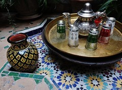 Moroccan hospitality (SM Tham) Tags: africa morocco marrakech riaddarelsouk courtyard floor tray teapot glasses vase mosaics zellige star patterns potplants