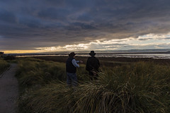 Hang on to your hats boys (cathbooton) Tags: sky clouds weather people hat landscape wirral canoneos beach path light water hills wales walk walking december