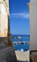 Beyond the walls ( Ivan) Tags: gallipoli lecce apulia puglia salento italy italia sea seaside walls castle boats pier blue sun landscape scape colours sky painting