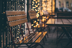It is the Bokeh Time of Year :) (freyavev) Tags: bokeh bokehlicious benches bench chair chairs table cafe outdoor vsco woodenchair woodenbench lights christmas christmaslights stuttgart deutschland germany schlossplatz 50mm niftyfifty mikasniftyfifty shallowdepthoffield cinematic