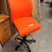 Orange high swivel chair