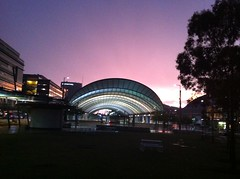 Sydney Olympic Park Train Station (Simon_sees) Tags: sunset storm public rain station architecture clouds train evening design dusk railway commute infrastructure publictransport sydneyolympicpark