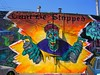 Can't Be Stopped (See El Photo) Tags: california ca street city blue red sky urban 15fav favorite orange streetart color colour building green eye art face hat car monster yellow cali wall illustration canon dead outside outdoors eos rebel death graffiti la losangeles scary hands alley parkinglot colorful paint day colore grafiti zombie vibrant character graf parking fingers lot vivid creepy boo melrose daytime spraypaint fav cans graff mummy wraps creature bandanna couleur cbs alleyart grafite automoblie cantbestopped cbscrew artedelacalle t1i creepyscare