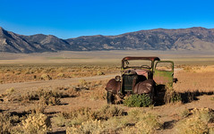Deserted (http://fineartamerica.com/profiles/robert-bales.ht) Tags: snow mountains ford beautiful vintage spectacular landscape photo junk desert antique awesome nevada rustic rusty surreal peaceful super retro nostalgia chrome transportation vehicle sensational headlight grille chassis windshield oldcar sublime magnificent rollinghills collector modelt classictruck ponyexpress haybales phonecase forupload scenicphotography oldcarandetc robertbales oldpickupoldtruck oldwestphotography oldcollectable schellbouonestation