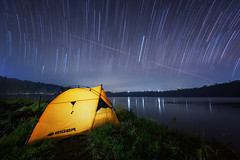 Camping in Buyan Lake (eggysayoga) Tags: longexposure camping camp bali lake yellow night indonesia star nikon tent adventure trail astrophotography eiger startrail 1635mm singaraja buyan d810 sirui