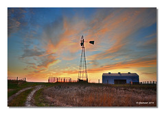 Nightfall_Windmill (rjmonner) Tags: ranch pink blue sunset shadow sky bw color net water windmill lines silhouette clouds rural fence dark outdoors evening twilight midwest gate darkness sundown wind dusk farm flag country farming profile scenic iowa well pump pastoral decrepit busted blades decayed agricultural clearing nightfall windpower relic disrepair cornbelt creaking jacksonco windmillwednesday