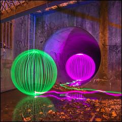Magenta Green (Rodrick Dale) Tags: toronto ontario canada lightpainting water reflections orb sewer culvert