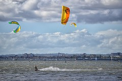A Good Day For Windsurfing (Tilney Gardner) Tags: sandbanks poole dorset coast harbour clouds nikon colour windsurfers