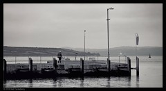 the ferry pier (Neil Tackaberry) Tags: tarbert ferrypier pier dock county co kerry countykerry cokerry irish scene dull ireland overcast calm mono monochrome bw greyscale 16x9 widescreen