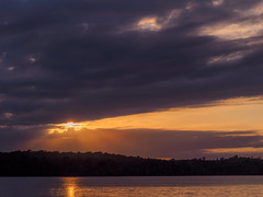 Sun's Passing By (jmcpheeters) Tags: clintonlake rays sun clouds sunset glow