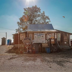 delta blues, dirt road, juke joint, mississippi pottery, and a partridge in a pear tree (jeneksmith) Tags: historic old hwy61 south southern cottonfield msbluestrail lettering words sign poormonkeyslounge jukejoint bluesmusic deltablues highway61 mississippi merigold building