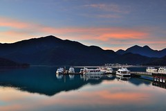 Dawn at Sun Moon Lake  (Vincent_Ting) Tags:        sunset clouds  sky taiwan water lake sunmoonlake sunrise    pier   morning dawn  galaxy        crepuscularrays vincentting  milkyway
