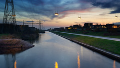 IJtocht (zsnajorrah) Tags: urban pylon water canal reflection transmissiontower repetition bench sunset evening bluehour dusk twilight longexposure 7dmarkii ef2470mmf4l netherlands hoofddorp overbos floriande explore