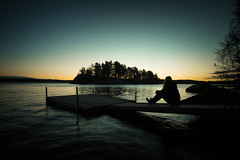 Unwind (Em-magic) Tags: lakescape landscape sweden sverige lake storarngen vrdns girl stergtland copyright wide samyang12mm fujifilm samyang nature reflections silhouette jetty calm mood sunrise dawn light gallery scandinavia island trees sky seascape jrnsen colourful morning early ripples xm1 tree water dark outdoor floating selfie self portrait fuji nordiclandscape windy tripod xsensor darkness weather clear