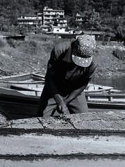 Boat fixing - Pokhara, Nepal (Tocsy) Tags: bw streetphotography nepalese people nepali nepal pokhara travel canon6d life