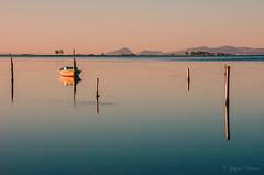 In Messolongi lagoon - Greece (Ipapanti Tomara) Tags: blue sea sun sunrise reflections landscape dawn daylight boat pentax lagoon calm greece serenity rest stillness calmness messolongi mesolongi