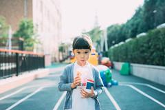 Frozen Drink. (MichelleSimonJadaJana) Tags: china girls portrait color girl childhood zeiss children t 50mm kid shanghai sony voigtlander documentary lifestyle m snaps carl jana manual   fullframe a7 jada f15 sonnar vme nex  zm adaptor a7r thirdpartylens vsco a7s emount ilce7r