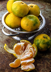 Ripe tangerines in bowl on the old background (gorobina) Tags: summer food orange color macro green home window nature beautiful leaves yellow tangerine fruit season table dessert outdoors wooden vegan juicy healthy natural bright sweet juice many background napkin seasonal group nobody bowl fresh clear