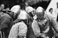 soldiers (cosmonautix) Tags: film analog soldier poland krakow medieval warrior analogue bnw helmets nikonn75 wianki historicalreconstruction jarmarkwitojaski wiankiwkrakowie stjohnsfair2014