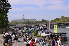 Grand Palais and the Seine River (oxfordblues84) Tags: bridge trees sky people paris france building water architecture clouds river europe bluesky tourists pedestrians leftbank grandpalais seineriver 5photosaday passerelleléopoldsédarsenghor pontdesolférino roadscholar roadscholartour
