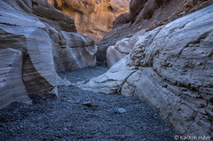 Death Valley 003 - Mosaic Canyon - 21249 (www.karltonhuberphotography.com) Tags: california color texture nature lines horizontal landscape outdoors nationalpark rocks alone quiet walk exploring details peaceful wideangle canyon hike erosion adventure solo haunting deathvalley geology wilderness quest spiritual upclose magical narrow impressive aweinspiring polished rockwalls slotcanyon flashflood naturephotography mosaiccanyon 2014 sigma1020mm deathvalleynationalpark leadinglines landscapephotography solohike wildplaces canyonwalls nikond7000 geologicwonder karltonhuber