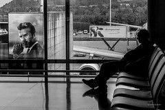 Wake up, it's time! (izzetta) Tags: sleeping people blackandwhite bw male monochrome airport funny time zurich watch streetphotography indoor beckham conceptual davidbeckham