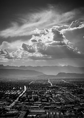 Vegas Days (jrodmanjr) Tags: city vegas urban bw black mountains streets weather clouds lights traffic lasvegas streetlights sony redrocks suburbs metropolitan pointshoot lighttrail landscope