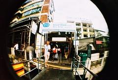 Bangkok street snap (lumieb) Tags: trip travel film 35mm thailand holga lomo lomography bangkok films fisheye 35mmfilm 135 bkk streetstyle filmphoto 135film holgafisheye holgak200 lomofilm film135 bangkokstreet filmpic bangkokstyle bangkokurban lomographyxpro200 xpro200 lomoanalogue 135photo