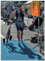 Chasing shadows (Hugh Stanton) Tags: bike race shadows helmet cycle triathalon