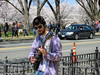 Man performing outside during the DC Cherry Blossom Festival, March, 2016. (dckellyphoto) Tags: man male person sunglasses guitar exterior washingtondc cherryblossom cherryblossoms festival trees bureauofengravingandprinting districtofcolumbia dc busker busking purpleshirt