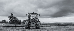 Ready to Roll (stevedewey2000) Tags: wiltshire salisburyplain blackandwhite desaturated monochrome bw tractor machinery farmmachinery agriculture countryside farming rollers johndeere wideangle