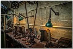 The polishing department (Hugh Stanton) Tags: bench lights polishers belts factory