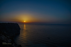 The sea at sunrise from the cliff (Oddiseis) Tags: formentera balearicislands spain lamola cape sea mediterranean waves sky sun sunrise silhouette tamron247028 colors coast litoral light lighthouse cliffs horizon water rocks rocky island ithak peaceful quiet shadows reflections morning