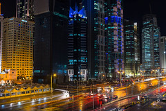 Neo Doha (Mohammad Alsaafin) Tags: cards night lighttrail doha rain architecture city qatar longexposure streets buildings