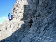 Mt Yamnuska Summit Scramble - A fellow hiker looks on a Ben descends from the ledge (benlarhome) Tags: yamnuska exshaw alberta canada scramble scrambling hike hiking trail path