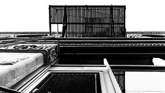 Escape From Below (Drake Dyck Photography) Tags: building lines bw contrast blackandwhite fireescape victoria downtown street
