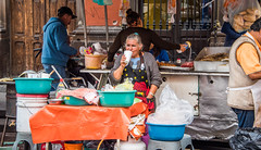 2016 - Mexico - San Luis Potosi - Street Food (Ted's photos - Returns late December) Tags: 2016 cropped mexico nikon nikond750 nikonfx sanluispotosi tedmcgrath tedsphotos tedsphotosmexico vignetting food apron cookong foodprep ballcap grill propanetank kitchen portablekitchen denim denimjeans cup styrofoam styrofoamcup pail bucket